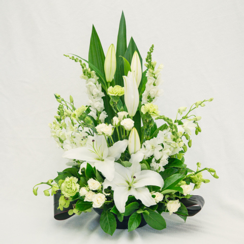 oriental lily's and orchid arrangement