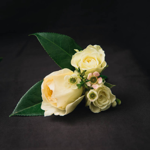 rose buttonhole white