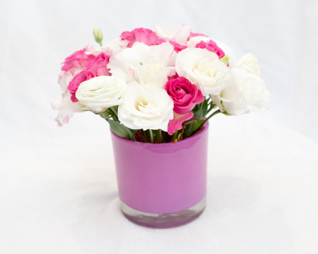 Pink vase with pink and white seasonal flowers