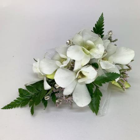 Corsage with white orchids and spray roses