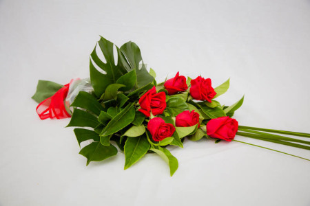 Bouquet of premium red roses with lush green foliage